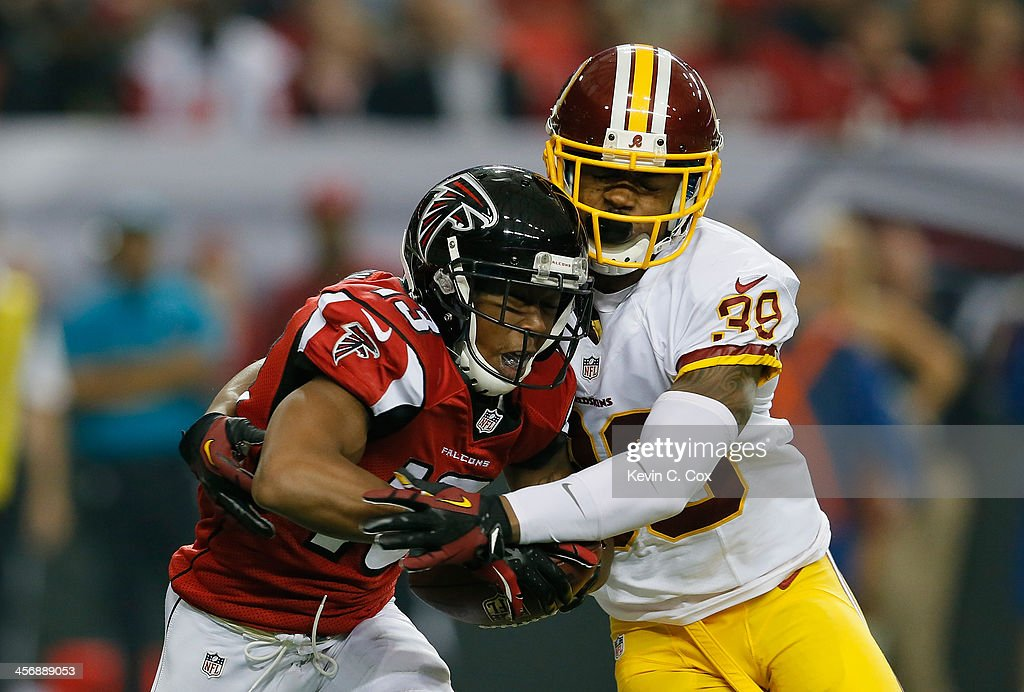 Darius Johnson #13 of the Atlanta Falcons pulls in this reception against <a gi-track='captionPersonalityLinkClicked' href=/galleries/search?phrase=David+Amerson&family=editorial&specificpeople=7244765 ng-click='$event.stopPropagation()'>David Amerson</a> #39 of the Washington Redskins at Georgia Dome on December 15, 2013 in Atlanta, Georgia.