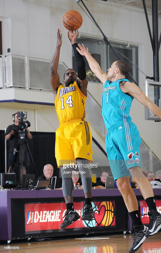 Darius Johnson-Odom #14 of the Los Angeles D-Fenders shoots the jumper against Mychel Thompson #17 of the Sioux Falls Skyforce on January 5, 2013 at Toyota Sports Center in El Segundo, California.