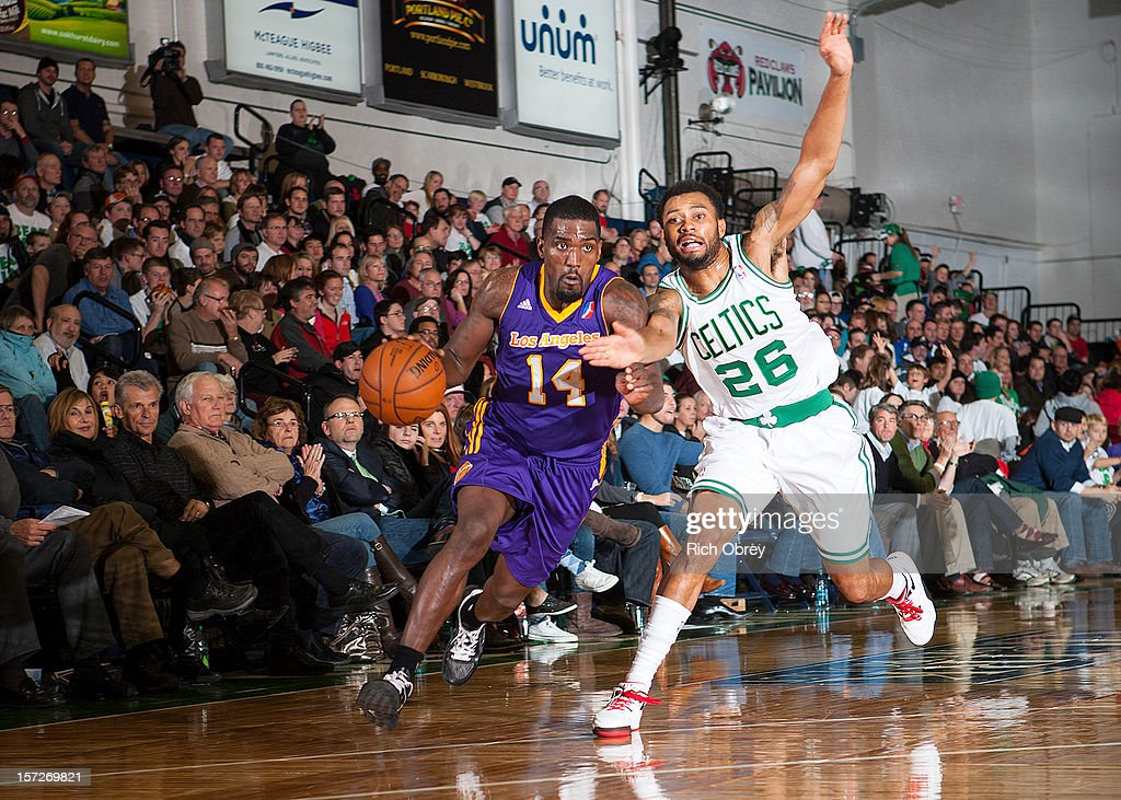 Darius Johnson-Odom #14 of the Los Angeles D-Fenders turns the corner on a drive against Xavier Silas #26 of the Maine Red Claws on November 30, 2012 at the Portland Expo in Portland, Maine.