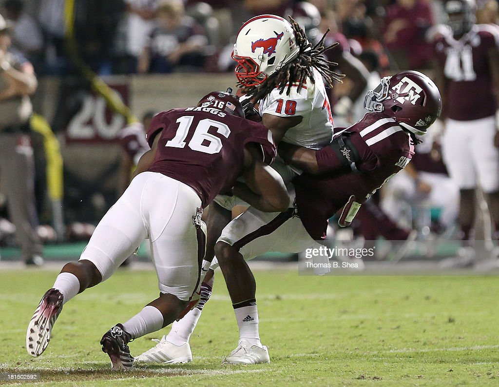 Darius Joseph #18 of the Southern Methodist Mustangs is tackled by Donnie Baggs #16 of the Texas A&M Aggies in the second half on September 21, 2013 at Kyle Field in College Station, Texas.