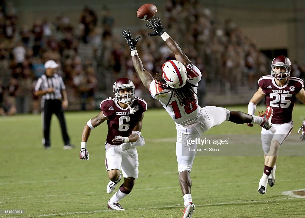 Darius Joseph #18 of the Southern Methodist Mustangs makes a catch against Noel Ellis #6 of the Texas A&M Aggies in the second half on September 21, 2013 at Kyle Field in College Station, Texas.