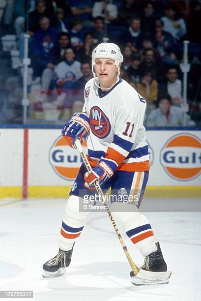 Darius Kasparaitis of the New York Islanders skates on the ice during an NHL game in November 1992 at the Nassau Coliseum in Uniondale New York