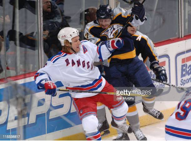 Darius Kasparaitis of the New York Rangers and Scott Hartnell during game between the New York Rangers and Nashville Predators December 8 2005