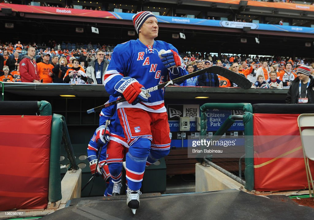 Darius Kasparaitis #6 of the New York Rangers walks out for warm-ups prior to the start of the Alumni game against the Philadelphia Flyers on December 31, 2011 in Philadelphia, Pennsylvania