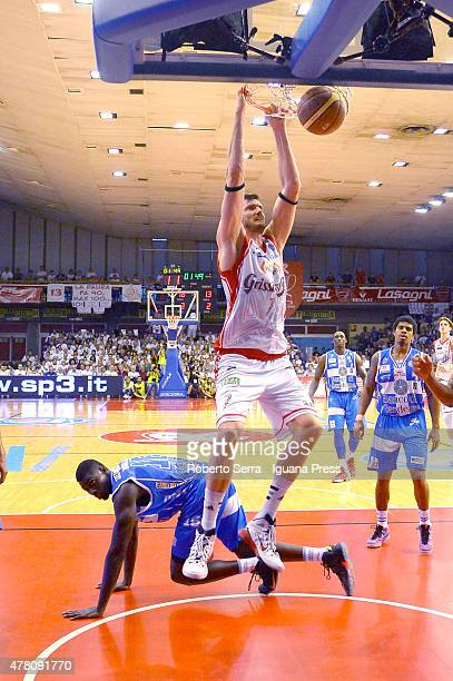 Darius Lavrinovic of Grissin Bon competes with Cheikh Mbodj of Banco di Sardegna during match 1 of the final series of the Italian LegaBasket Serie A...