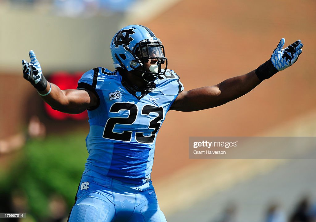 Darius Lipford #23 of the North Carolina Tar Heels pumps up the crowd during a win over the Middle Tennessee State Blue Raiders at Kenan Stadium on September 7, 2013 in Chapel Hill, North Carolina. North Carolina won 40-20.