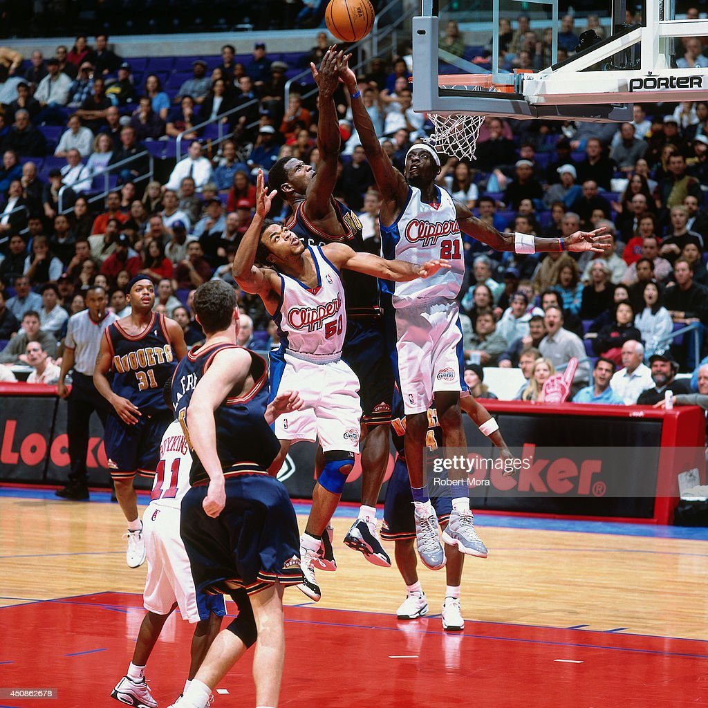 <a gi-track='captionPersonalityLinkClicked' href=/galleries/search?phrase=Darius+Miles&family=editorial&specificpeople=201702 ng-click='$event.stopPropagation()'>Darius Miles</a> #21 and <a gi-track='captionPersonalityLinkClicked' href=/galleries/search?phrase=Corey+Maggette&family=editorial&specificpeople=201596 ng-click='$event.stopPropagation()'>Corey Maggette</a> #50 of the Los Angeles Clippers goes up for a rebound against the Denver Nuggets on January 10, 2001 at Staples Center in Los Angeles, CA.
