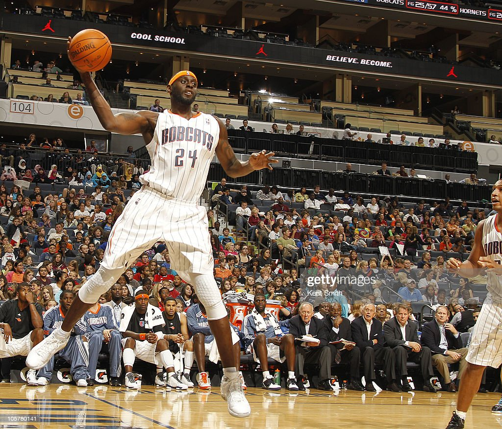 <a gi-track='captionPersonalityLinkClicked' href=/galleries/search?phrase=Darius+Miles&family=editorial&specificpeople=201702 ng-click='$event.stopPropagation()'>Darius Miles</a> #24 of the Charlotte Bobcats makes a pass against the New Orleans Hornets on October 20, 2010 at Time Warner Cable Arena in Charlotte, North Carolina.