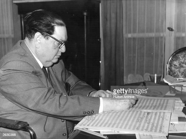 Darius Milhaud the prolific modern French composer composing in his Paris apartment
