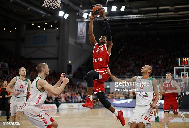 Darius Miller #21 of Brose Baskets Bamberg competes with Adam Hanga #8 of Laboral Kutxa Vitoria Gasteiz in action during the 20152016 Turkish...