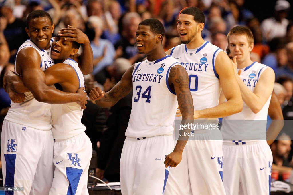 Darius Miller Brandon Knight DeAndre Liggins Eloy Vargas and Jon Hood of the Kentucky Wildcats celebrate after they won 7163 against the West...