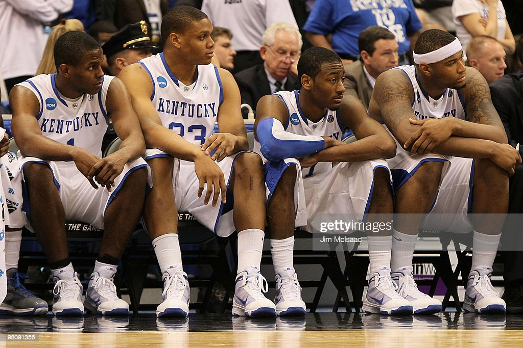 Darius Miller Daniel Orton John Wall and DeMarcus Cousins of the Kentucky Wildcats sit dejected on the bench during the final minutes of the second...