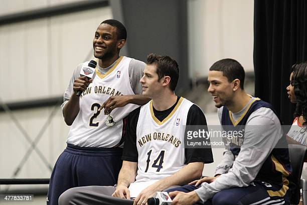 Darius Miller Jason Smith and Austin Rivers of the New Orleans Pelicans join teammates as they host a season ticket holders event on March 8 2014 at...