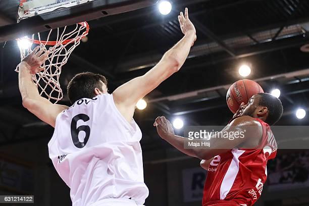 Darius Miller of Brose Bamberg is challenged by Filip Barovic of Telekom Baskets Bonn during the BBL Bundesliga match between Telekom Baskets Bonn...
