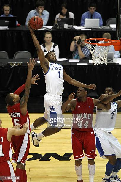 Darius Miller of the Kentucky Wildcats dunks against George Fant of the Western Kentucky Hilltoppers during the second round of the 2012 NCAA Men's...