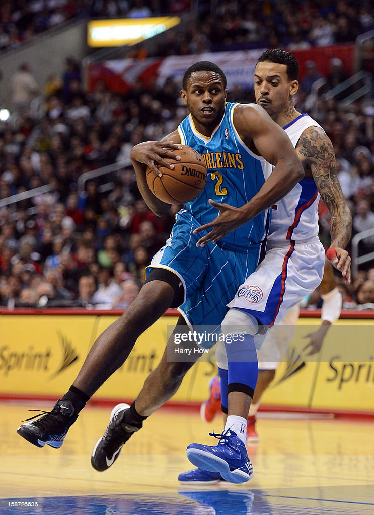Darius Miller #2 of the New Orleans Hornets drives past Matt Barnes #22 of the Los Angeles Clippers during a 93-77 Clipper victory for their 11th straight win at Staples Center on December 19, 2012 in Los Angeles, California.