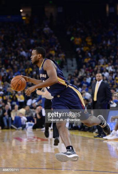 Darius Miller of the New Orleans Pelicans dribbles the ball against the Golden State Warriors at ORACLE Arena on December 17 2013 in Oakland...
