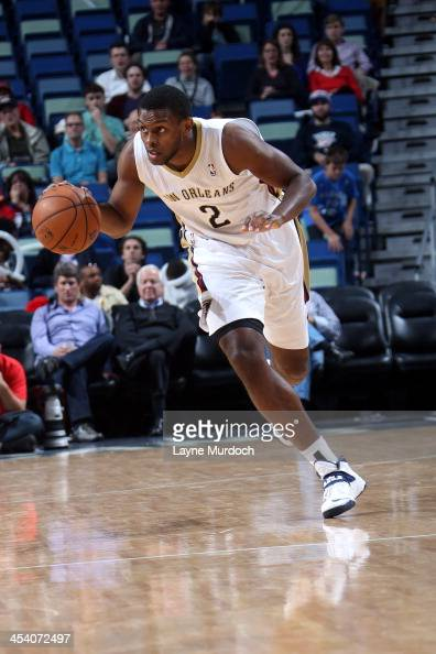 Darius Miller of the New Orleans Pelicans dribbles up the court against the Oklahoma City Thunder during an NBA game on December 6 2013 at the New...