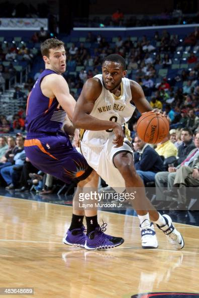 Darius Miller of the New Orleans Pelicans drives against the Phoenix Suns on April 09 2014 at the Smoothie King Center in New Orleans Louisiana NOTE...
