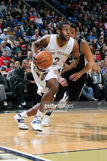 Darius Miller of the New Orleans Pelicans drives baseline against the San Antonio Spurs during an NBA game on January 13 2014 at the New Orleans...