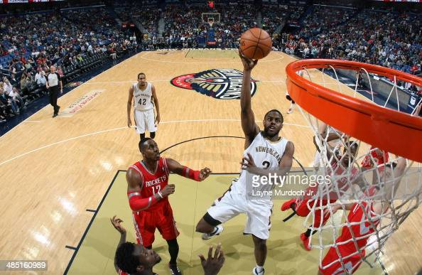 Darius Miller of the New Orleans Pelicans goes up for a shot against the Houston Rockets during an NBA game on April 16 2014 at the Smoothie King...