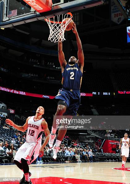 Darius Miller of the New Orleans Pelicans goes up for the dunk against John Jenkins of the Atlanta Hawks on October 6 2014 at Philips Arena in...