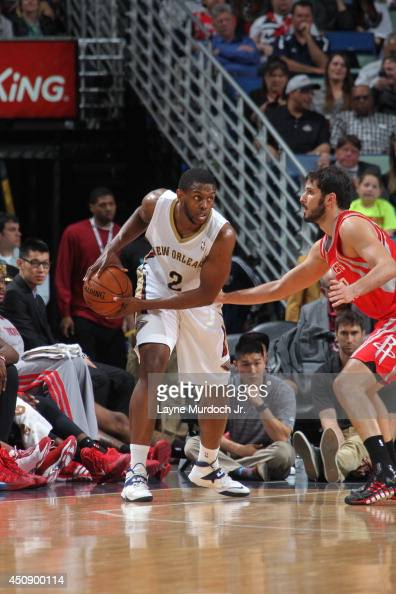 Darius Miller of the New Orleans Pelicans handles the ball against the Houston Rockets on April 16 2014 at the Smoothie King Center in New Orleans...