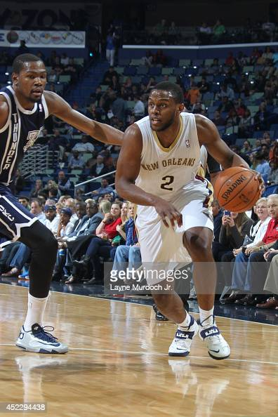 Darius Miller of the New Orleans Pelicans handles the ball against the Oklahoma City Thunder during an NBA game on April 14 2014 at the Smoothie King...