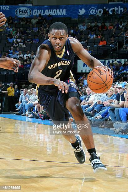 Darius Miller of the New Orleans Pelicans handles the ball against the Oklahoma City Thunder on April 11 2014 at the Chesapeake Energy Arena in...