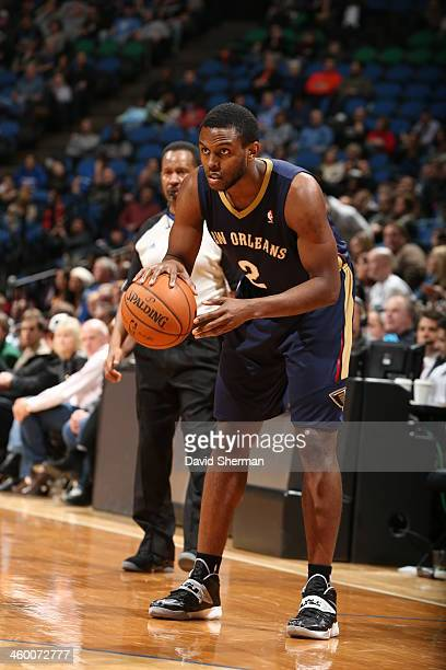 Darius Miller of the New Orleans Pelicans looks to pass the ball against the Minnesota Timberwolves during the game on January 1 2014 at Target...