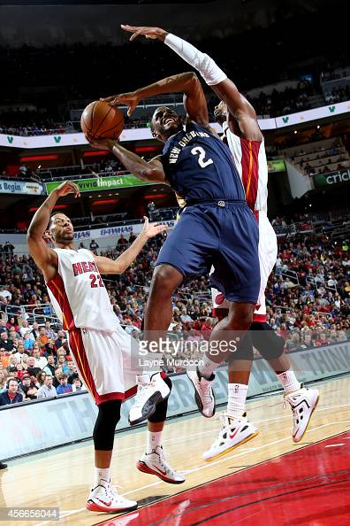 Darius Miller of the New Orleans Pelicans shoots against the Miami Heat during an NBA game on October 4 2014 at the KFC Yum Center in Louisville KY...
