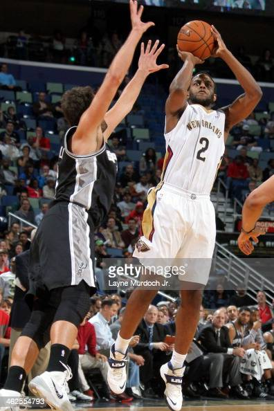Darius Miller of the New Orleans Pelicans shoots the ball against the San Antonio Spurs during an NBA game on January 13 2014 at the New Orleans...