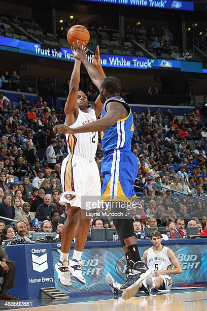 Darius Miller of the New Orleans Pelicans shoots the ball against the Golden State Warriors during an NBA game on January 18 2014 at the New Orleans...