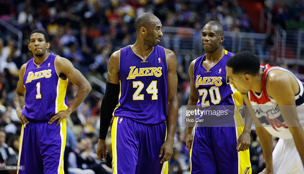 Darius Morris #1, <a gi-track='captionPersonalityLinkClicked' href=/galleries/search?phrase=Kobe+Bryant&family=editorial&specificpeople=201466 ng-click='$event.stopPropagation()'>Kobe Bryant</a> #24, and <a gi-track='captionPersonalityLinkClicked' href=/galleries/search?phrase=Jodie+Meeks&family=editorial&specificpeople=4001727 ng-click='$event.stopPropagation()'>Jodie Meeks</a> #20 of the Los Angeles Lakers walk up the floor during the second half against the Washington Wizards at Verizon Center on December 14, 2012 in Washington, DC.