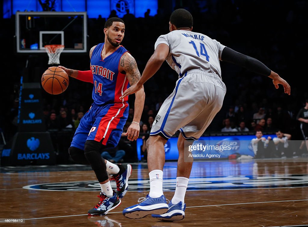 Darius Morris of Brooklyn Nets in action against DJ Augustin of Detroit Pistons during NBA basketball game between Brooklyn Nets and Detroit Pistons...