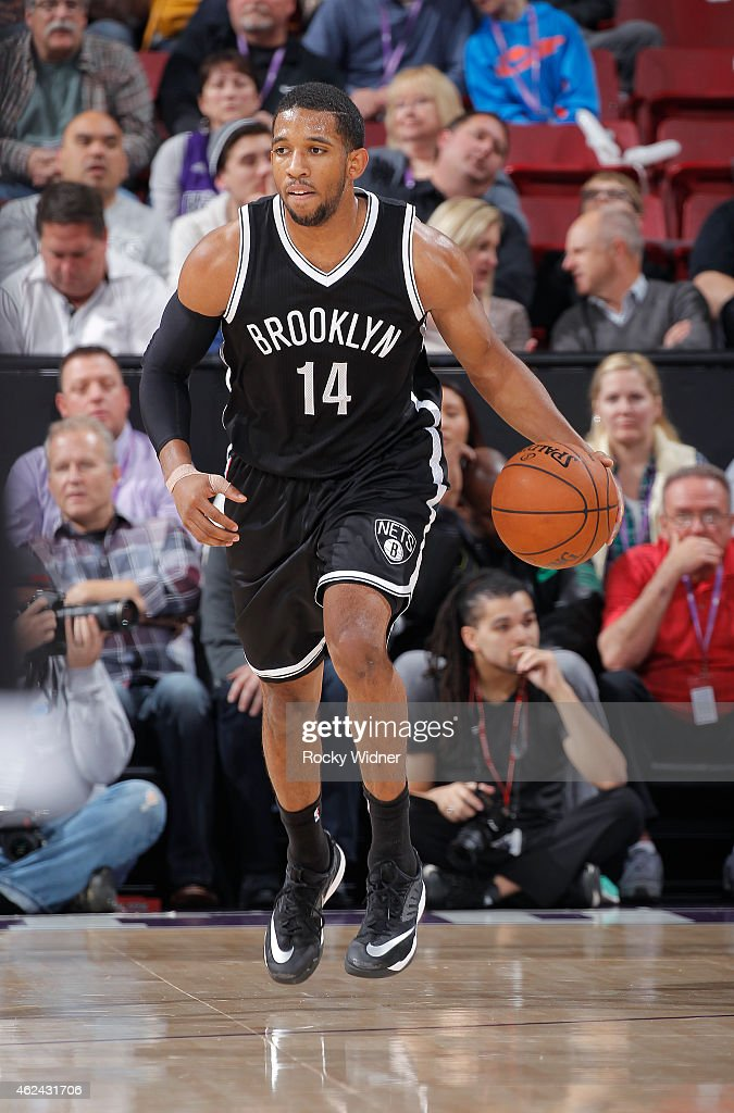 Darius Morris of the Brooklyn Nets brings the ball up the court against the Sacramento Kings on January 21 2015 at Sleep Train Arena in Sacramento...