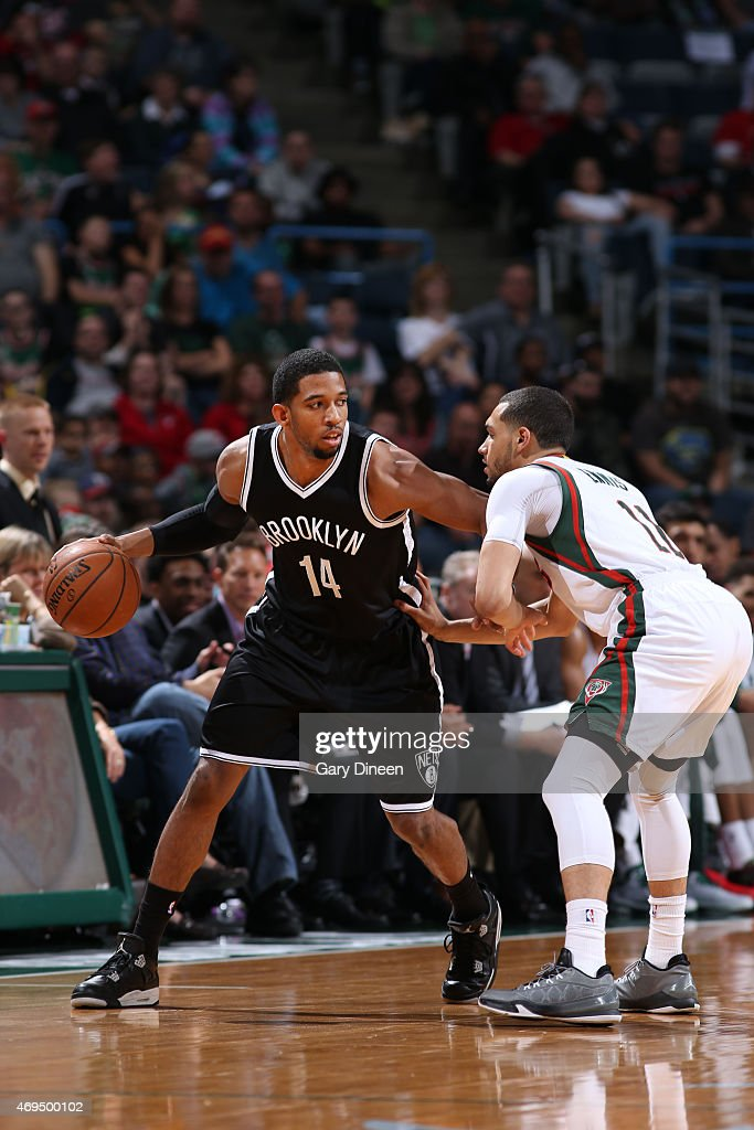 Darius Morris of the Brooklyn Nets defends the ball against the Milwaukee Bucks during the game on April 12 2015 at BMO Harris Bradley Center in...