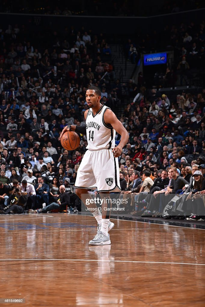 Darius Morris of the Brooklyn Nets dribbles the ball while looking to pass against the Memphis Grizzlies at the Barclays Center on January 14 2015 in...