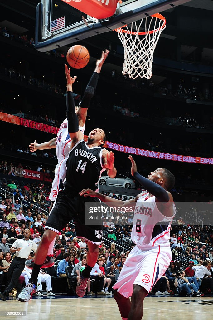 Darius Morris of the Brooklyn Nets goes for the layup against the Atlanta Hawks during the game on April 4 2015 at Philips Arena in Atlanta Georgia...