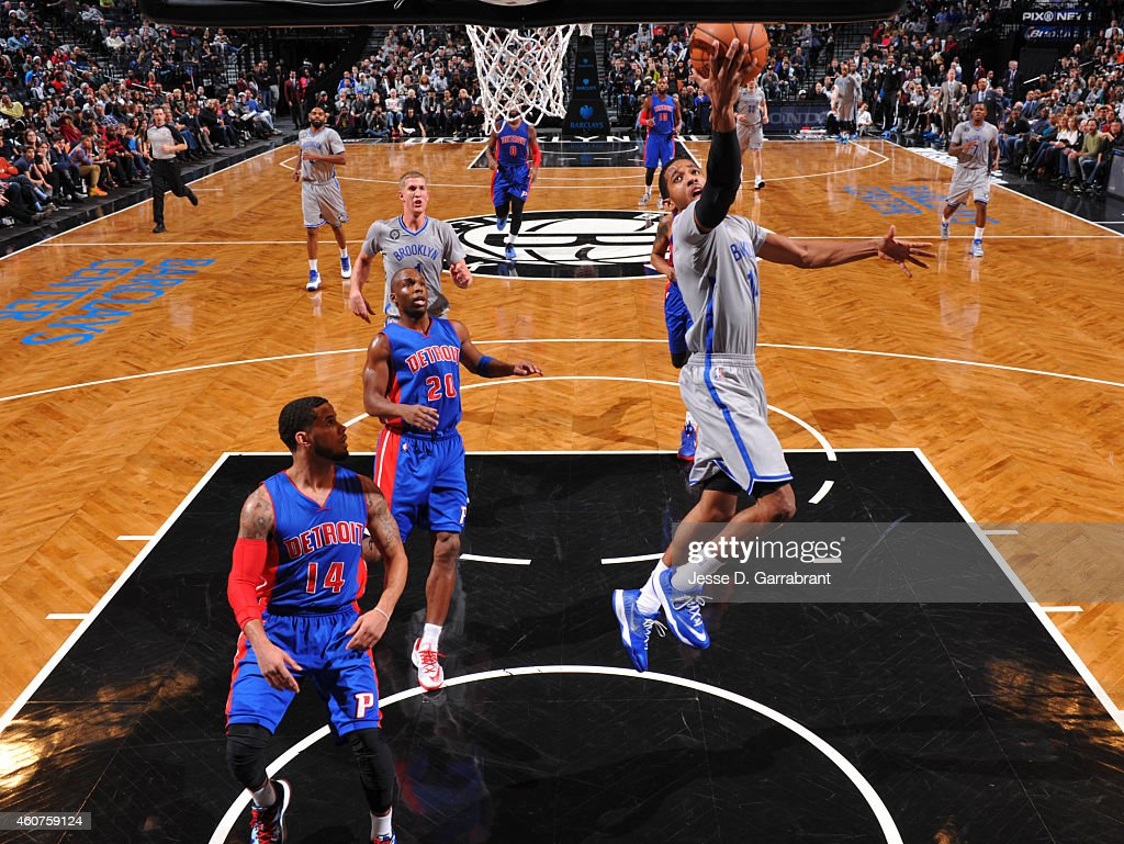 Darius Morris of the Brooklyn Nets goes up for the layup against the Detroit Pistons on December 21 2014 at the Barclays Center in Brooklyn NY NOTE...