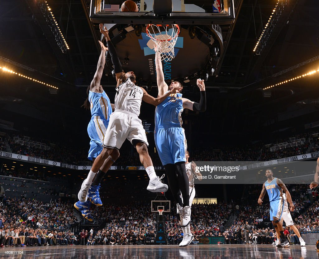 Darius Morris of the Brooklyn Nets goes up for the layup against the Denver Nuggets on December 23 2014 at the Barclays Center in Brooklyn NY NOTE TO...