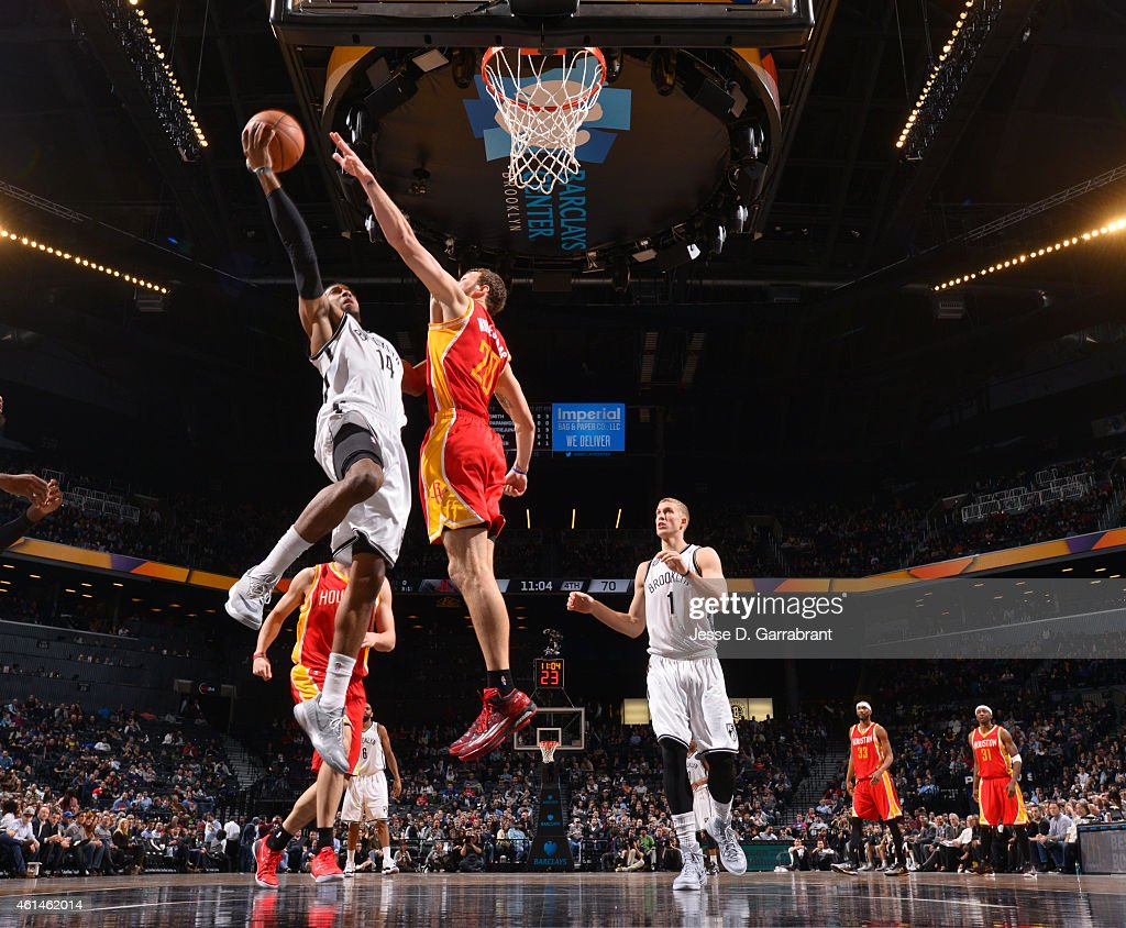 Darius Morris of the Brooklyn Nets goes up for the layup against the Houston Rockets at the Barclays Center on January 12 2015 in Brooklyn NY NOTE TO...