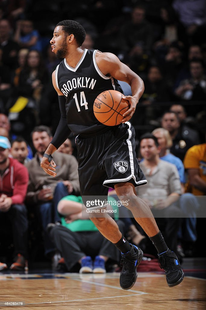 Darius Morris of the Brooklyn Nets handles the ball against the Denver Nuggets on February 23 2015 at the Pepsi Center in Denver Colorado NOTE TO...