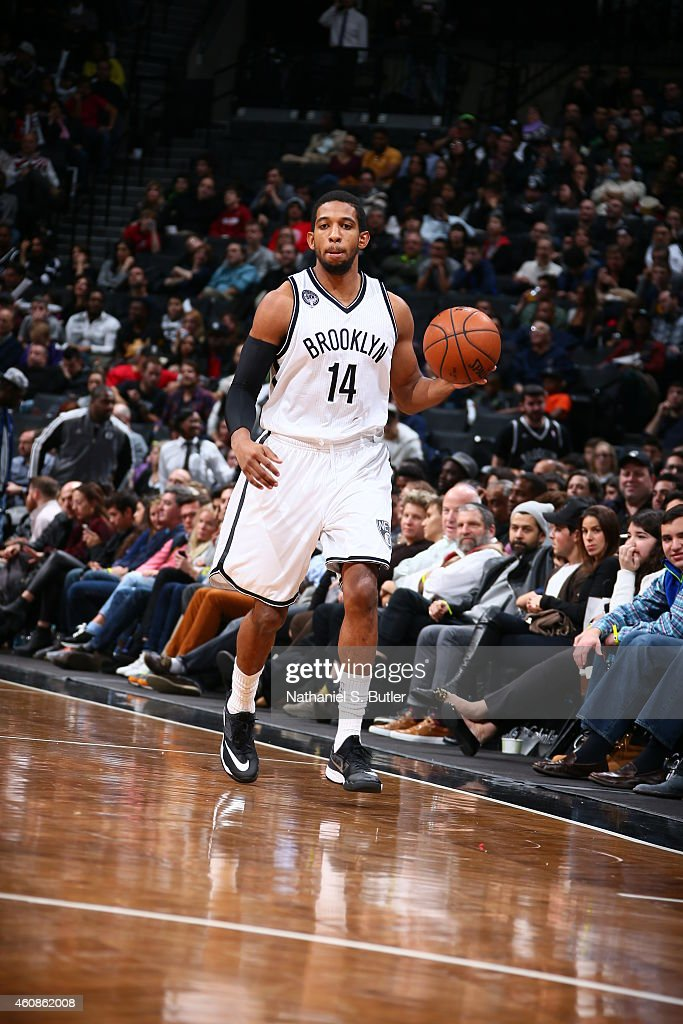 Darius Morris of the Brooklyn Nets handles the ball against the Indiana Pacers during the game on December 27 2014 at Barclays Center in Brooklyn New...