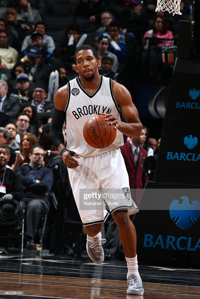 Darius Morris of the Brooklyn Nets handles the ball against the Boston Celtics during the game on January 7 2015 at Barclays Center in Brooklyn New...