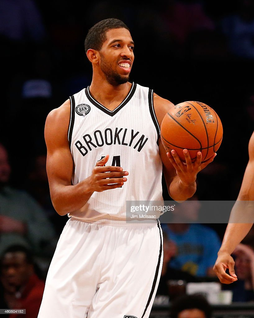 Darius Morris of the Brooklyn Nets in action against the Philadelphia 76ers at Barclays Center on December 12 2014 in the Brooklyn borough of New...