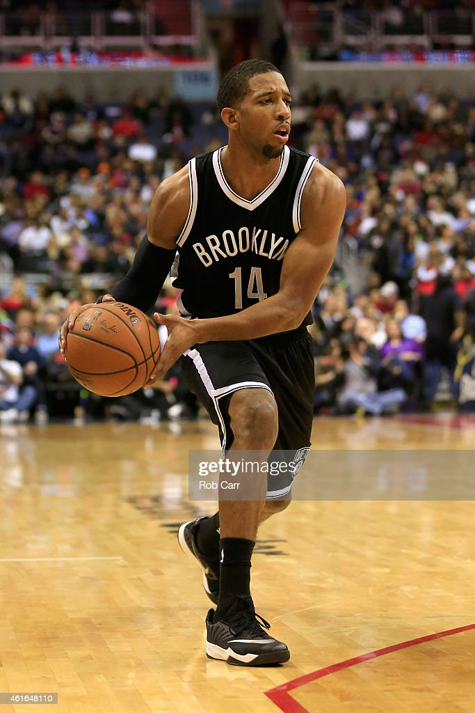 Darius Morris of the Brooklyn Nets looks to pass against the Washington Wizards during the first half at Verizon Center on January 16 2015 in...