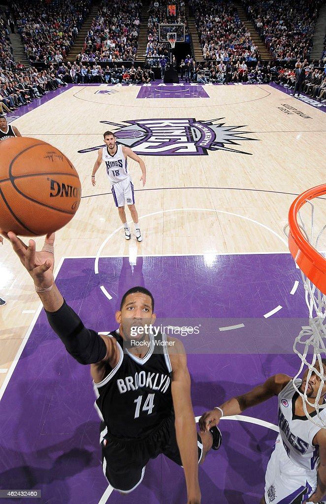 Darius Morris of the Brooklyn Nets shoots a layup against the Sacramento Kings on January 21 2015 at Sleep Train Arena in Sacramento California NOTE...