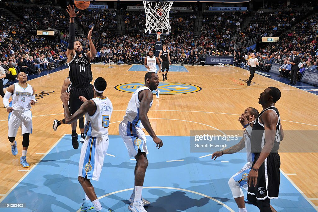 Darius Morris of the Brooklyn Nets shoots against the Denver Nuggets on February 23 2015 at the Pepsi Center in Denver Colorado NOTE TO USER User...