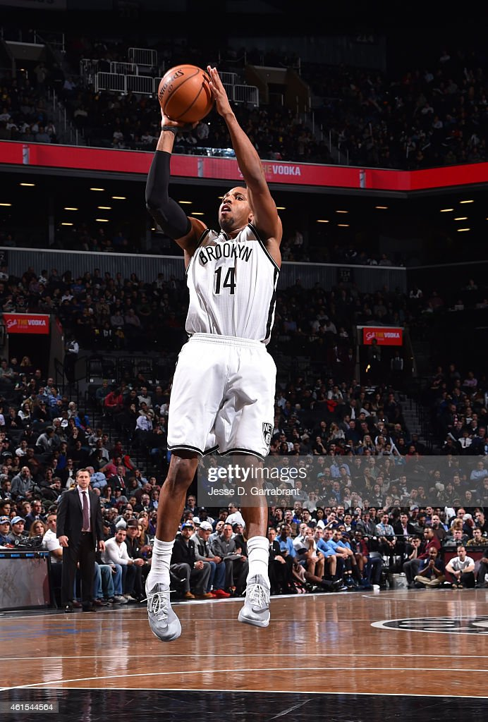 Darius Morris of the Brooklyn Nets shoots the ball against the Memphis Grizzlies at the Barclays Center on January 14 2015 in Brooklyn NY NOTE TO...